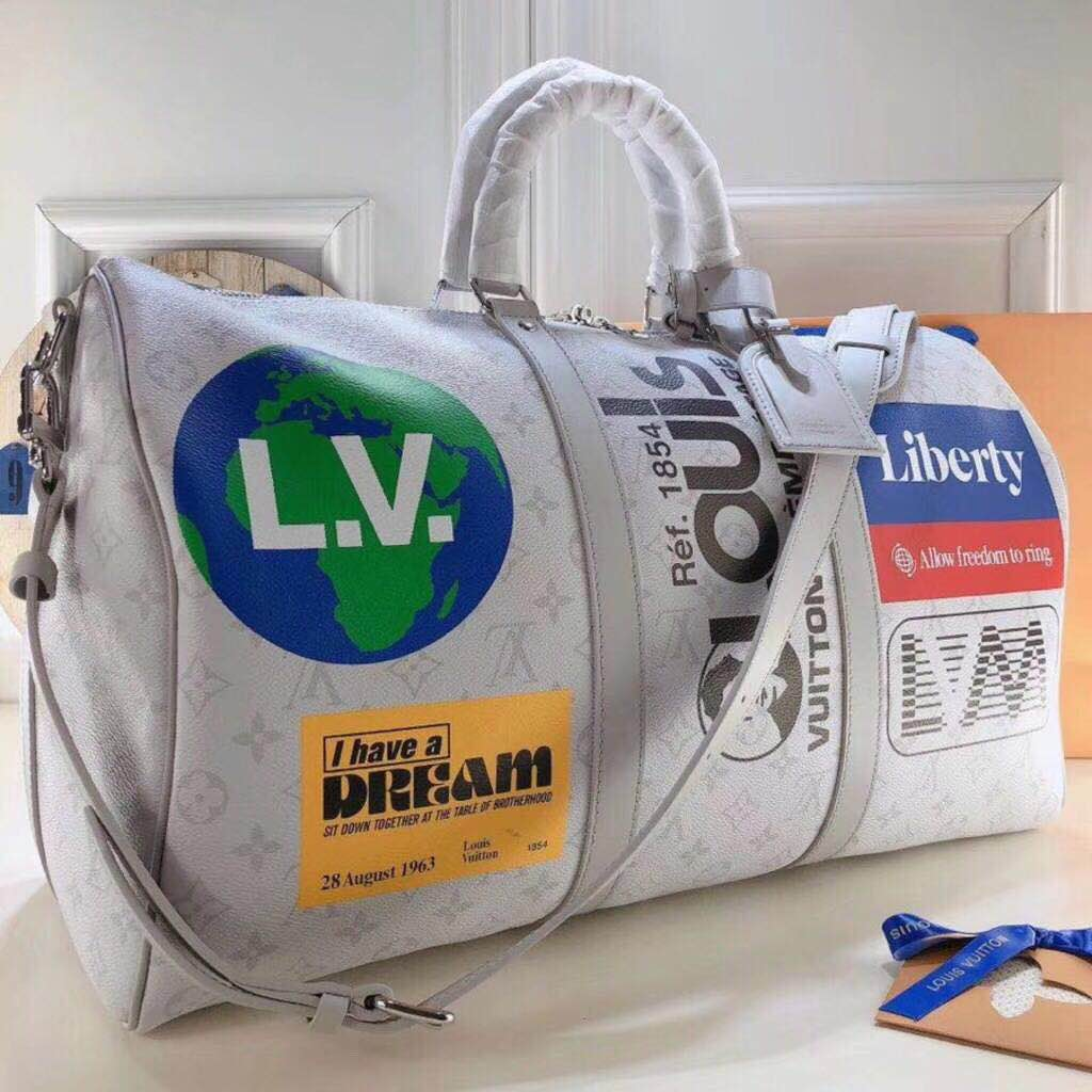Louis Vuitton Luminous Liberty Luggage in Grey - FashionBeast
