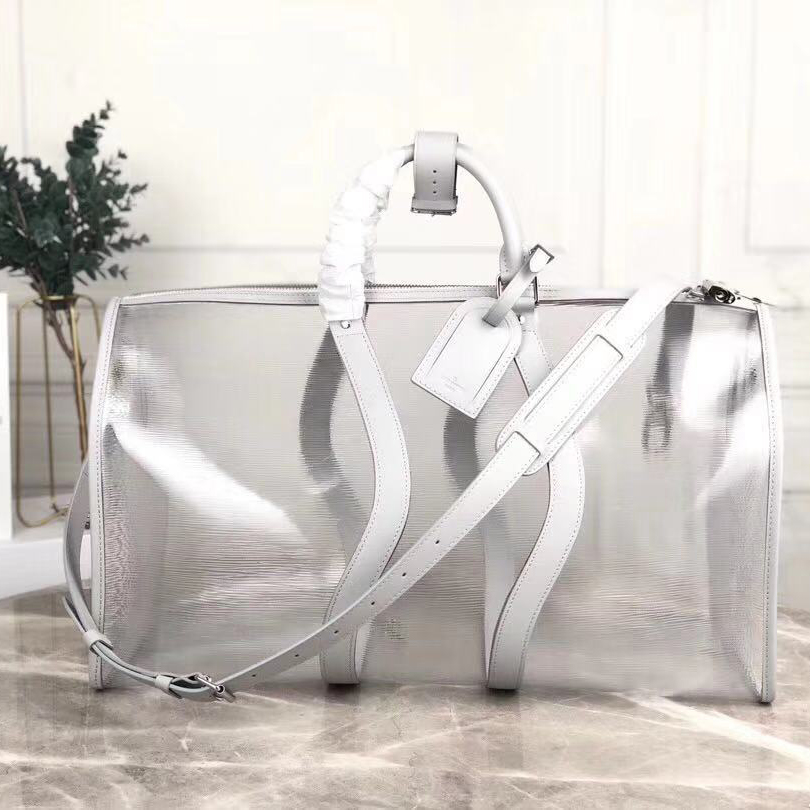 Louis Vuitton Keepall Bandouliere 50 Luggage in Silver White - FashionBeast